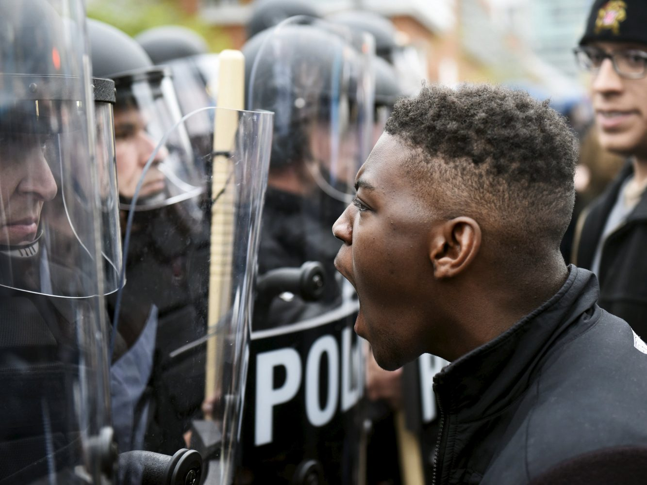 A demonstrator confronts police near Camden Yards during a protest against the death in police custody of Freddie Gray in Baltimore April 25, 2015. At least 2,000 people protesting the unexplained death of Gray, 25, while in police custody marched through downtown Baltimore on Saturday, pausing at one point to confront officers in front of Camden Yards, home of the Orioles baseball team. REUTERS/Sait Serkan Gurbuz