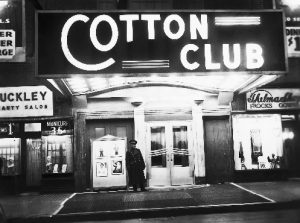 """ca. 1920s-1940s, Harlem, Manhattan, New York, New York, USA --- The night spot that best evokes glittering images of Harlem in the 1920s and 1930s is the Cotton Club. While literary urbanites appreciated Harlem Renaissance writers like Langston Hughes, more fun-loving New Yorkers were attracted to the neighborhood's vibrant cabarets. If you were white and well-heeled, you could enjoy African American entertainers like Louis Armstrong and Bill """"Bojangles"""" Robinson at the elegant Cotton Club. --- Image by © Underwood & Underwood/CORBIS"""