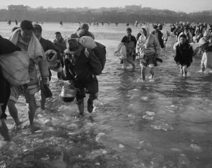 Koreans Fleeing Pyongyang braving the icy waters of the Taedong River. December 10, 1950