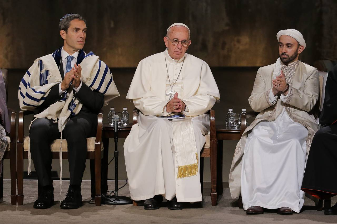 During+the+Catholic+Popes+visit+to+the+United+States+he+met+at+ground+zero+of+the+9%2F11+World+Trade+Center+attacks+for+an+interfaith+prayer+service.++Here+he+is+pictured+with+a+Jewish+Rabbi+and+Islamic+Iman.