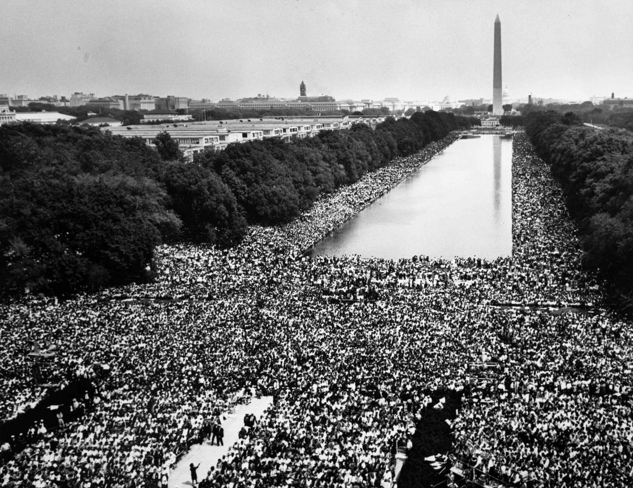 Hundreds of thousands of marchers gather around the reflecting pool in front of the Washington monument and listen as the Rev. Martin Luther King Jr. delivers his
