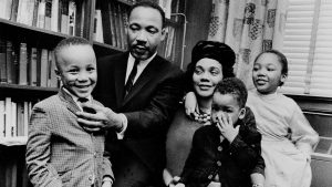 Dr. Martin Luther King Jr. and his wife, Coretta Scott King, sit with three of their four children in their Atlanta, Ga, home, on March 17, 1963. From left are: Martin Luther King III, 5, Dexter Scott, 2, and Yolanda Denise, 7.