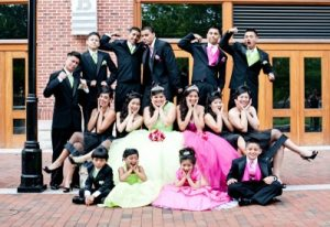 Here is a quincenera girl with her escorts and maid of honors of different ages .