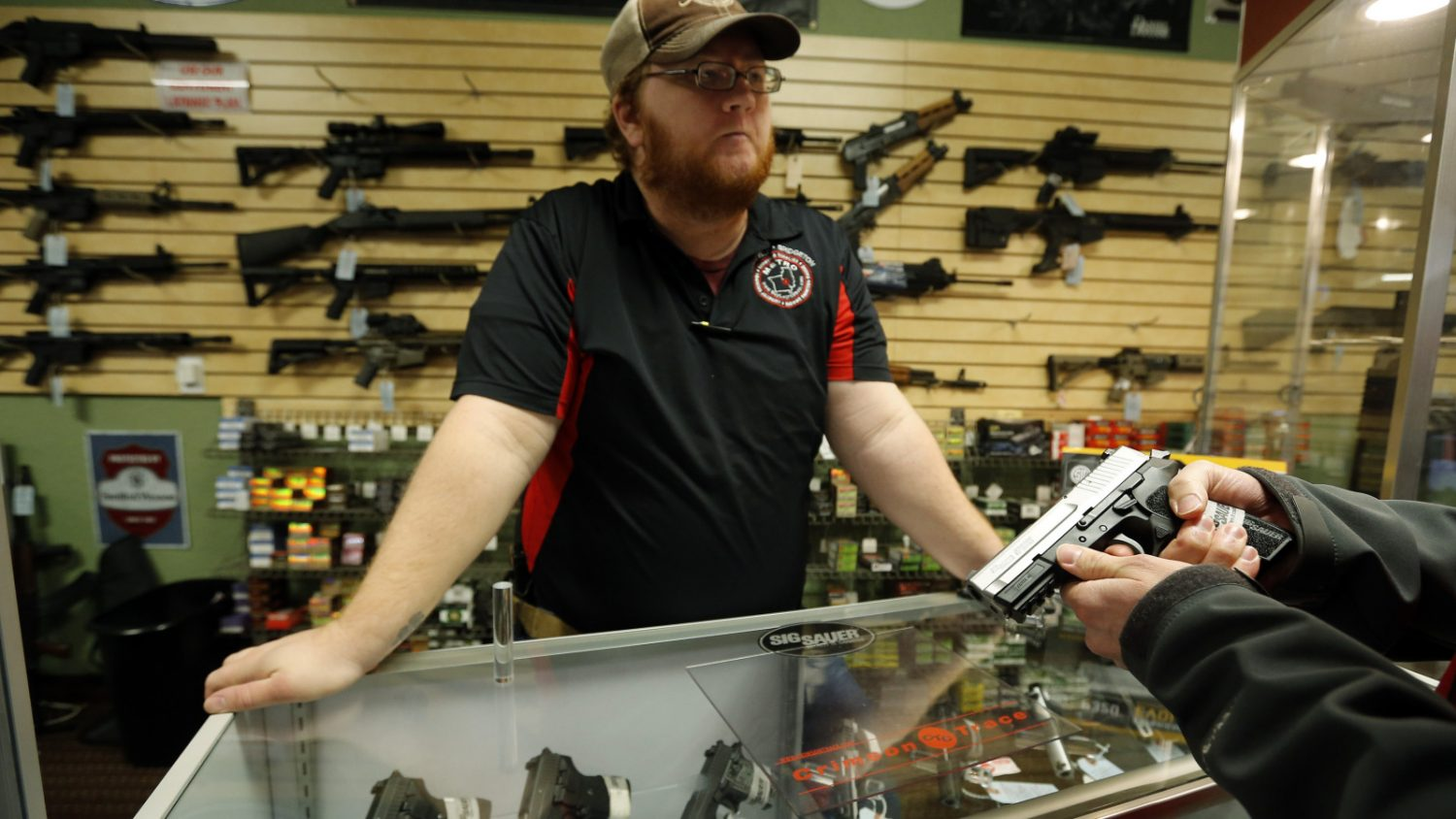 Metro+Shooting+Supplies%27+employee+Chris+Cox+speaks+to+a+customer+about+the+purchase+of+a+9mm+handgun+in+Bridgeton%2C+Missouri%2C+November+13%2C+2014.+The+store+has+reported+an+increase+in+gun+sales+as+the+area+waits+for+a+grand+jury+to+reach+a+decision+this+month+on+whether+to+indict+Darren+Wilson%2C+the+white+police+officer+who+shot+and+killed+the+18-year-old+Mike+Brown%2C+who+was+black%2C+on+Aug.+9+in+the+St.+Louis+suburb+of+Ferguson.+REUTERS%2FJim+Young++%28UNITED+STATES+-+Tags%3A+CRIME+LAW+CIVIL+UNREST+POLITICS%29+-+RTR4E2I1