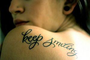 smile-phrase-tattoo-500x336