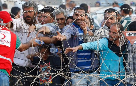 Kurdish refugees at the Turkish border earlier this year.