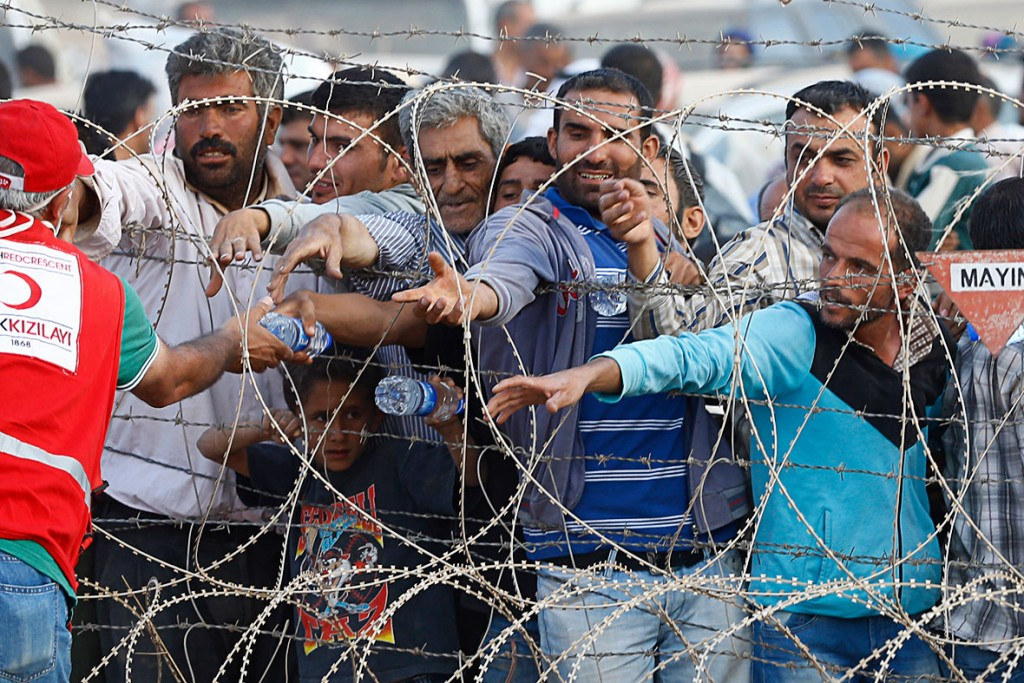 Kurdish+refugees+at+the+Turkish+border+earlier+this+year.