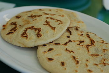 English: Pupusas seem so plain on the outside....