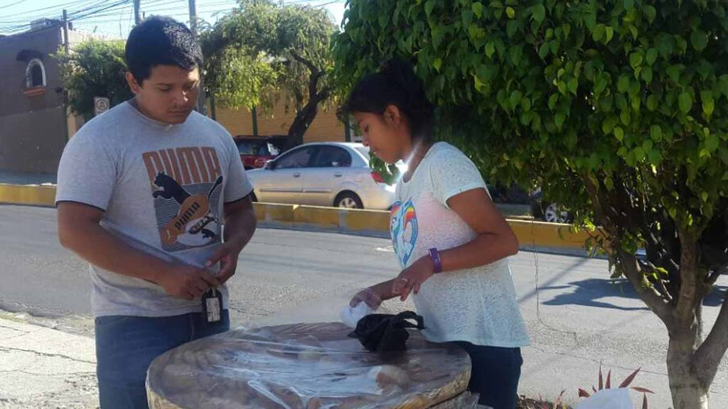 Selling bread on the streets helps Esperanza to make money for education in El Salvador