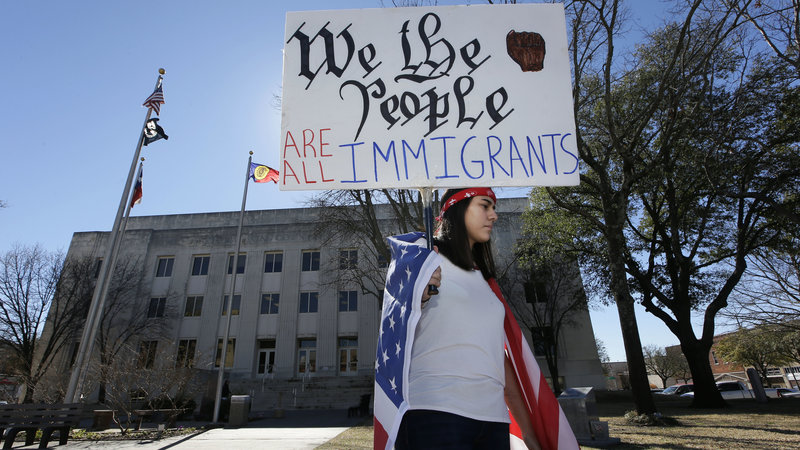 Observing+a+Day+Without+Immigrants%2C+high+school+senior+Vicky+Sosa+holds+a+sign+outside+the+Grayson+County+courthouse+in+Sherman%2C+Texas%2C+Thursday.