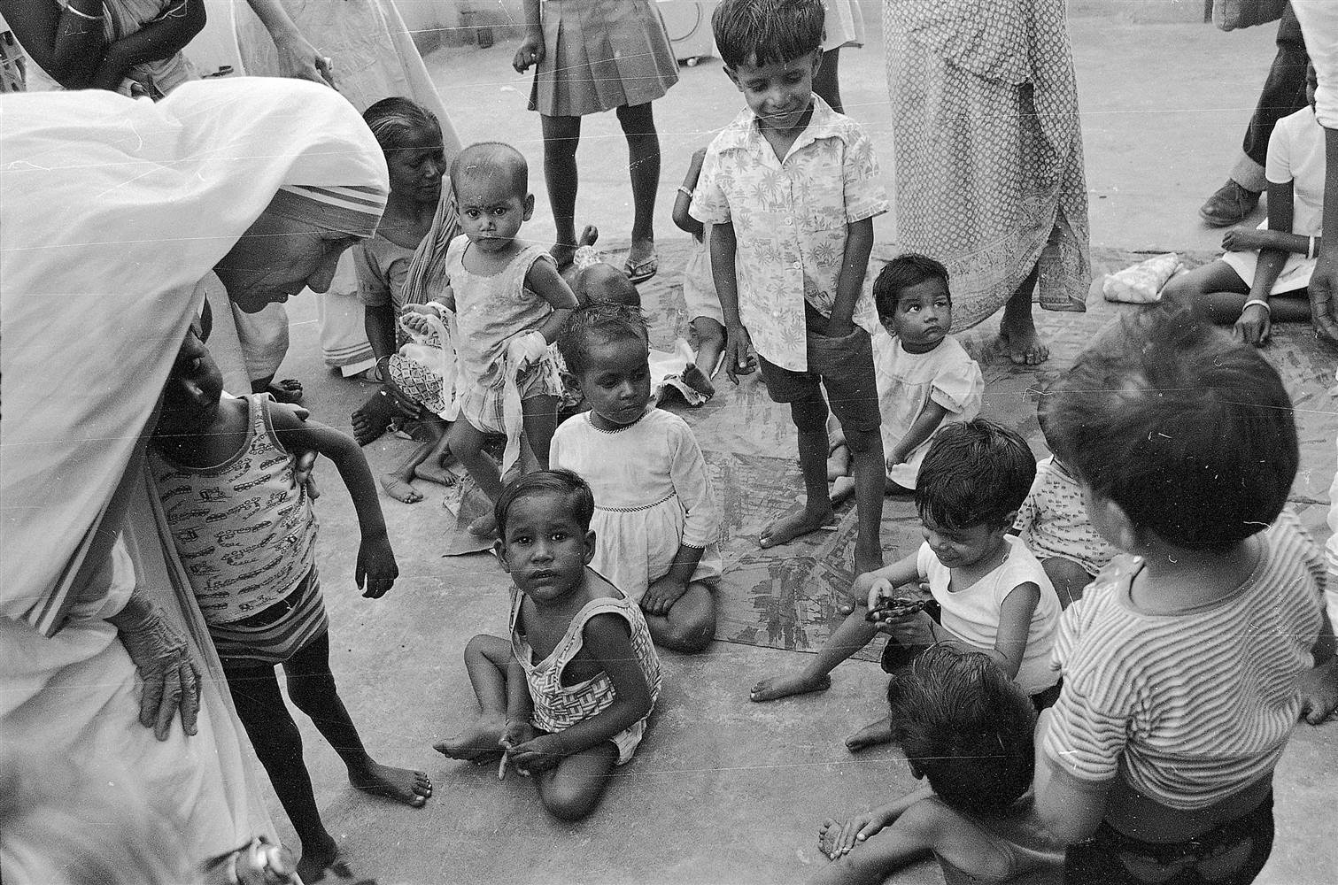 Image result for mother teresa helping people
