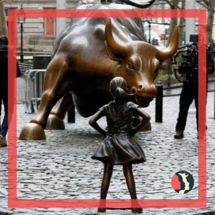 In+NYC+a+statue+of+a+young+lady+faces+the+power+of+the+bull+on+Wall+Street.++This+image+is+symbolic+of+women+seeking+equality+in+the+business+world+today.
