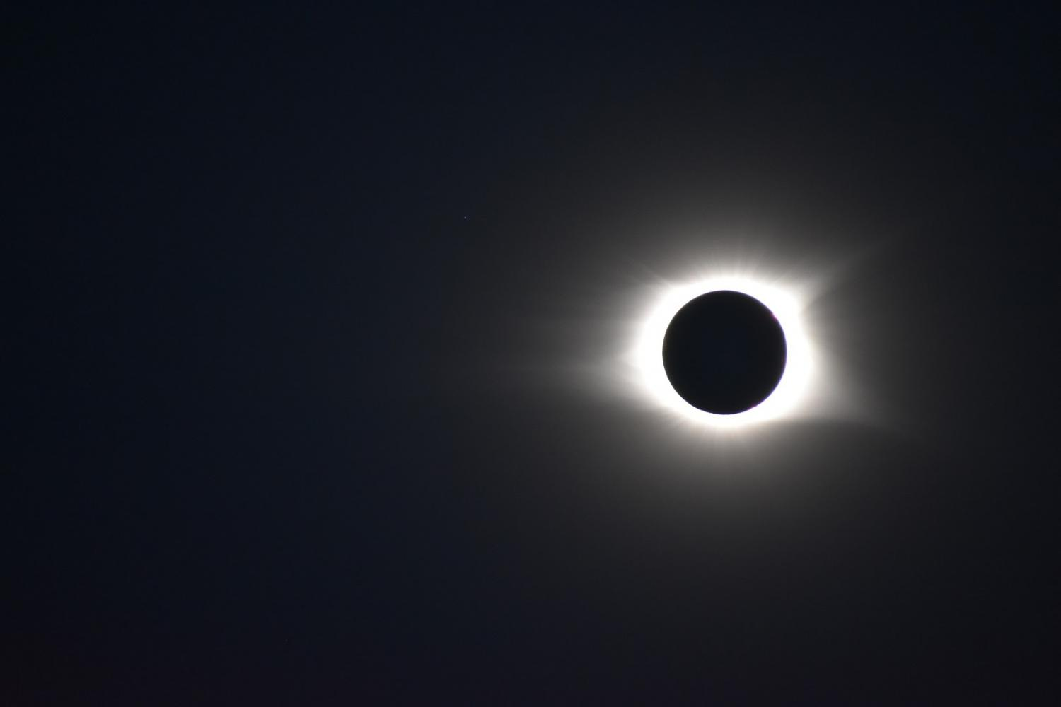 This photo of eclipse totality was taken by Jeff Jones in South Carolina.  Notice the star in the upper left.