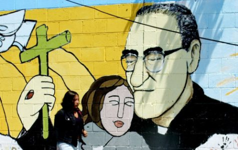 A woman passes a mural of slain Bishop Oscar Arnulfo Romero in Santa Tecla, some 8 miles from San Salvador, Tuesday, March 22, 2005. Salvadorans are commemorating the 25th anniversary of the murder of Bishop Oscar Arnulfo Romero on March 24. (AP Photo/Luis Romero) ** EFE OUT**
