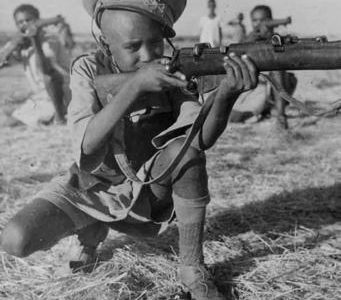 Young boys fighting Italy for the freedom of  modern Ethiopia in 1935