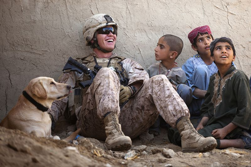 Marine hang out with afghan kids
