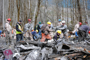 Rescuers searching for missing victims of the mudslide.