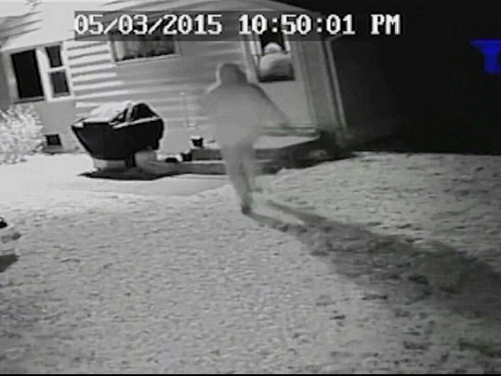 A burglar walking towards the house of Christine Beebe